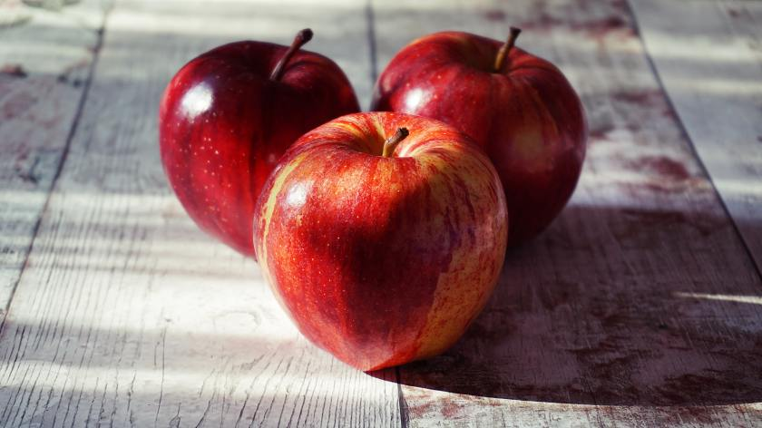 three-red-apples-on-wooden-surface-1510392