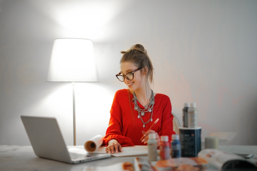 woman-in-red-long-sleeve-shirt-looking-at-her-laptop-3765132